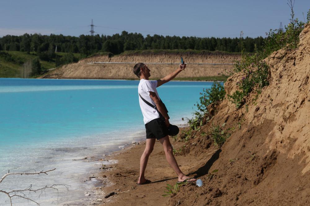 A man takes a selfie near an energy plant's ash dump site in Novosibirsk, Russia.
