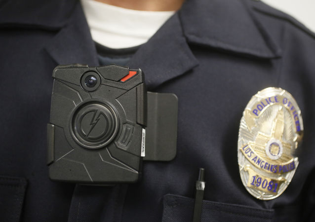 FILE- In this Jan. 15, 2014 file photo a Los Angeles Police officer wears an on-body camera