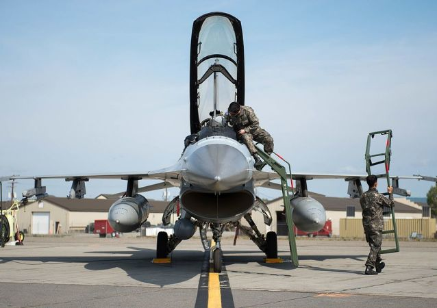 Members of the Republic of Korea Air Force (ROKAF) inspect their F-16D Fighting