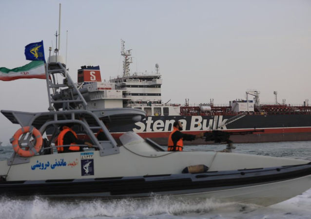 A boat of Iranian Revolutionary Guard sails next to Stena Impero, a British-flagged vessel owned by Stena Bulk, at Bandar Abbas port, in this undated handout photo