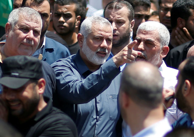 Hamas Chief Ismail Haniyeh, Gaza's Hamas Chief Yehya Al-Sinwar, and other Palestinian factions' leaders take part in a protest against Bahrain's workshop for U.S. Middle East peace plan, in Gaza City, June 26, 2019
