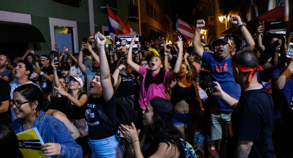 Demonstrators celebrate after the resignation of Puerto Rico Governor Ricardo Rossello in San Juan, Puerto Rico, July 24, 2019