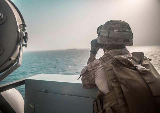 U.S. Marine Corps Cpl. Michael Weeks, ranges nearby boats from USS John P. Murtha during a Strait of Hormuz transit, Arabian Sea off Oman, in this picture released by U.S. Navy on July 18, 2019