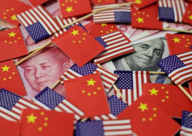 A U.S. dollar banknote featuring American founding father Benjamin Franklin and a China's yuan banknote featuring late Chinese chairman Mao Zedong are seen among U.S. and Chinese flags in this illustration picture taken May 20, 2019
