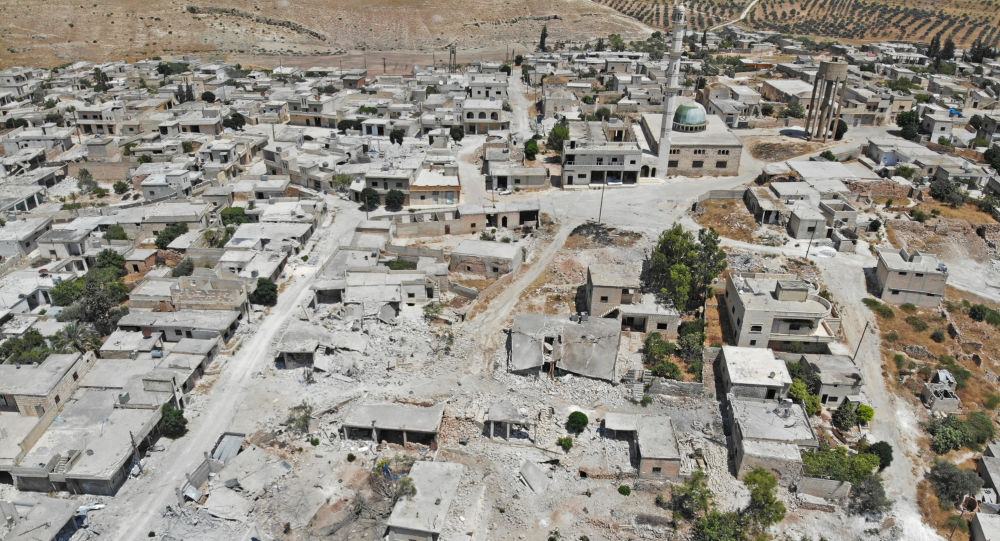 This aerial view taken on August 5, 2019 shows a view of damaged and destroyed buildings in the town of Maaret Hurmah in the southern countryside of Syria's northwestern Idlib province