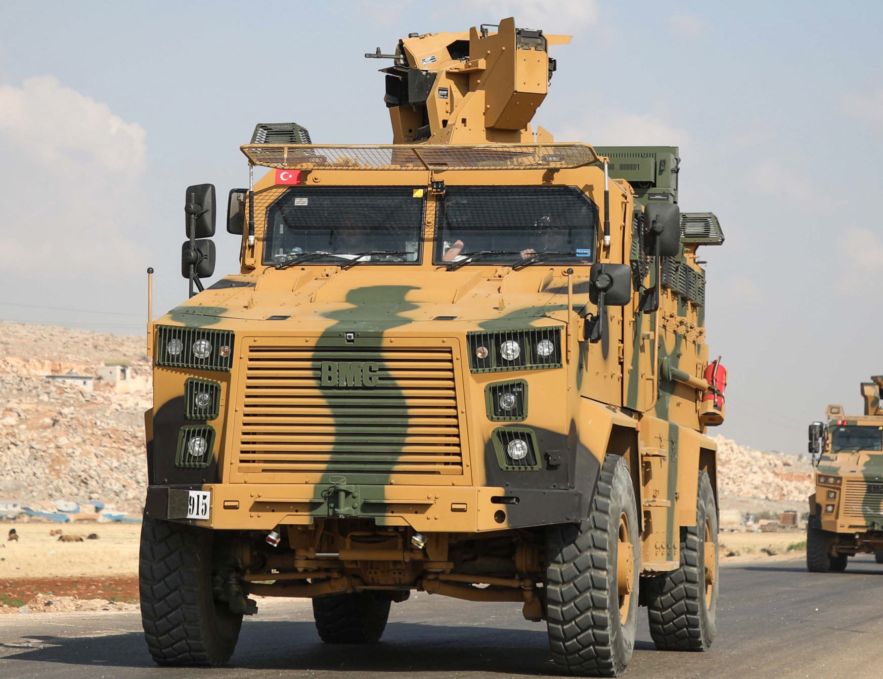A convoy of Turkish armoured vehicles drive towards Bab al-Hawa crossing point between Syria and Turkey on a highway in the northern countryside of the Syrian province of Idlib on June 20, 2019.