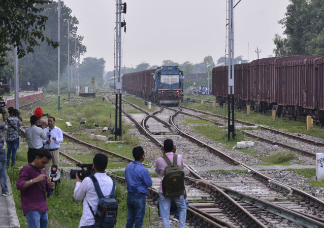 Journalists wait by the station as the Samjhauta Express, a train that runs between Delhi in India and Lahore in Pakistan, arrives in Attari, a town along the border with Pakistan, in the northern Indian state of Punjab, Thursday, Aug. 8, 2019