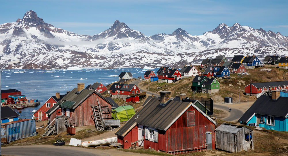Snow covered mountains rise above the harbour and town of Tasiilaq, Greenland, June 15, 2018