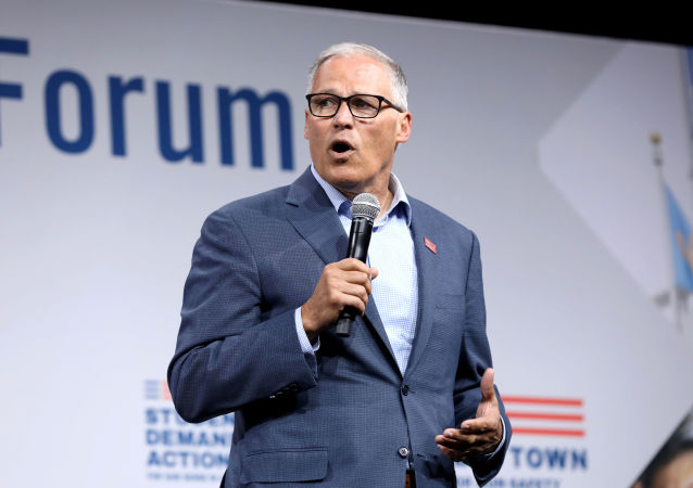 FILE PHOTO: 2020 Democratic U.S. presidential candidate and Washington Governor Jay Inslee speaks during the Presidential Gun Sense Forum in Des Moines, Iowa, U.S., August 10, 2019