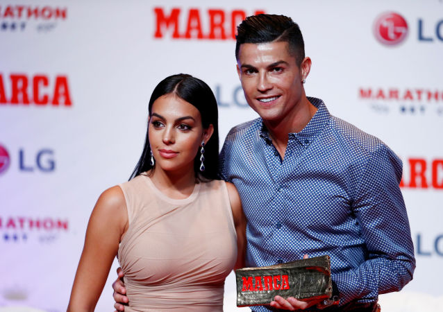 Soccer Football - Cristiano Ronaldo receives the MARCA Legend award - Reina Victoria Theater, Madrid, Spain - July 29, 2019   Cristiano Ronaldo poses with partner Georgina Rodriguez and the MARCA Legend award