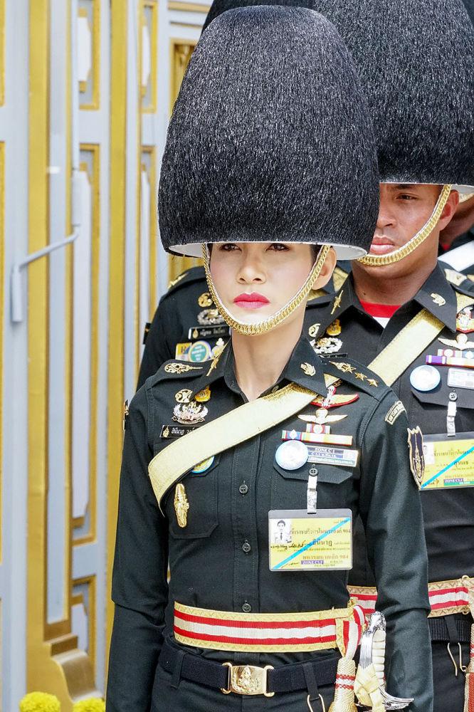 Parachuting and Firing a Gun: Rare Photos of Thai King's Consort