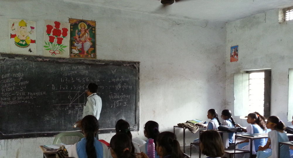 A teacher explaining a maths concept using TESS-India explained example