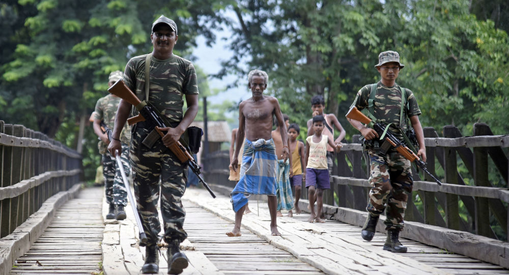 Indian security personnel patrol on a road ahead of the publication of the final draft of the National Register of Citizens (NRC) at Kachari Para village, in Hojai district, northeastern state of Assam, India August 30, 2019.
