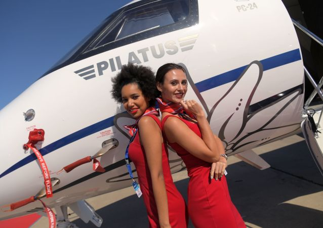 Girls posing for photos in front of the Swiss Pilatus PC-24 business jet at the MAKS-2019 international aviation and space show in Zhukovsky outside Moscow.