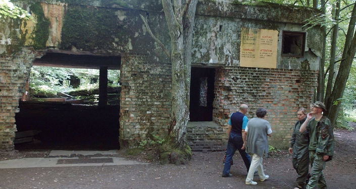 Tourists stroll round the ruins of Adolf Hitler's headquarters, the Wolf's Lair, in Gierloz, northern Poland