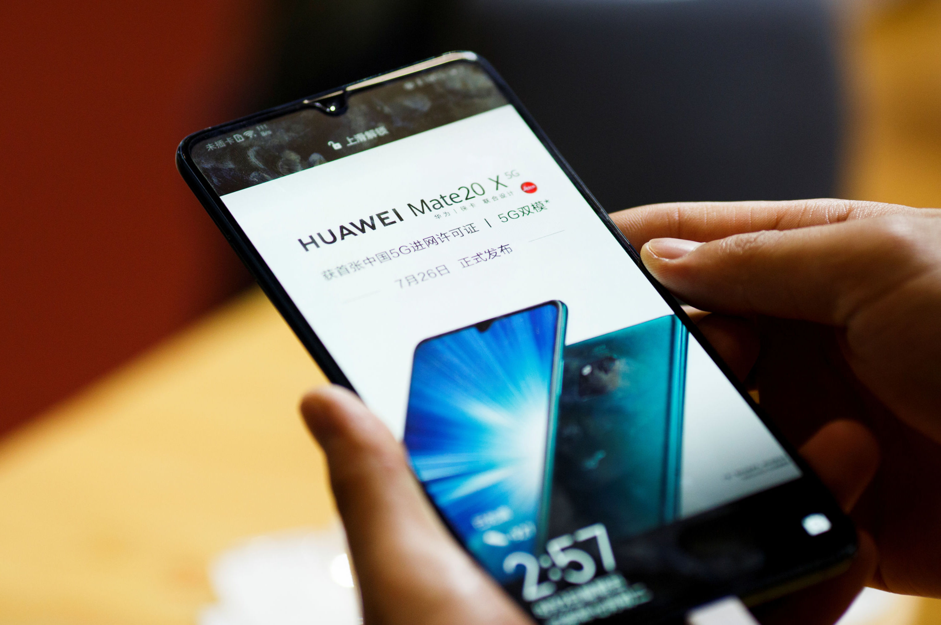 A man holds a Huawei Mate 20 X 5G smartphone at the International Consumer Electronics Expo in Beijing, China August 2, 2019