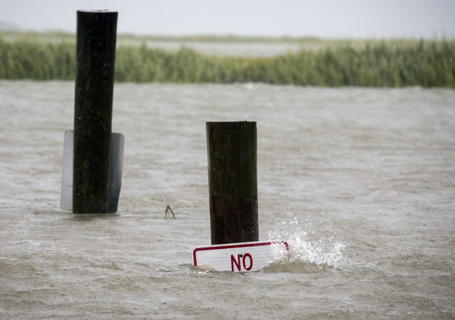 A sign at the Lazaretto Creek boat ramp as is nearly underwater at high tide as Hurricane Dorian makes its way up the east coast, Wednesday, Sept. 4, 2019, toward Tybee Island, Ga. Dorian is forecast to bring storm surge and tropical storm force winds the barrier island. (AP Photo/Stephen B. Morton)