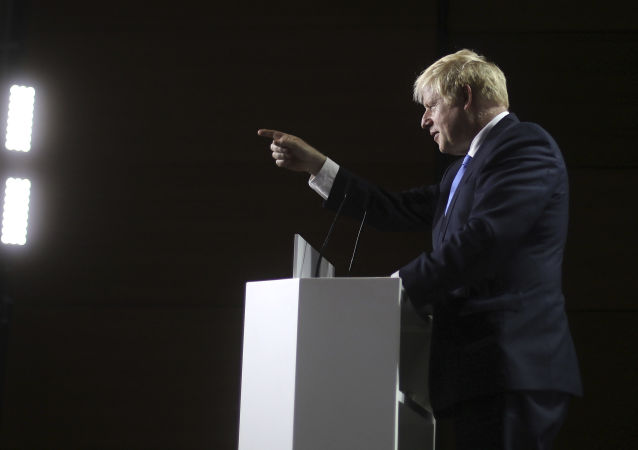 Britain's Prime Minister Boris Johnson gestures as he speaks during a press conference on the third and final day of the G-7 summit in Biarritz, France Monday, 26 August 2019