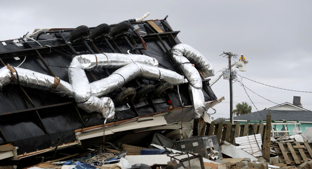 Power company lineman work to restore power after a tornado hit Emerald Isle, N.C. as Hurricane Dorian moved up the East coast on Thursday, Sept. 5, 2019. (AP Photo/Tom Copeland)