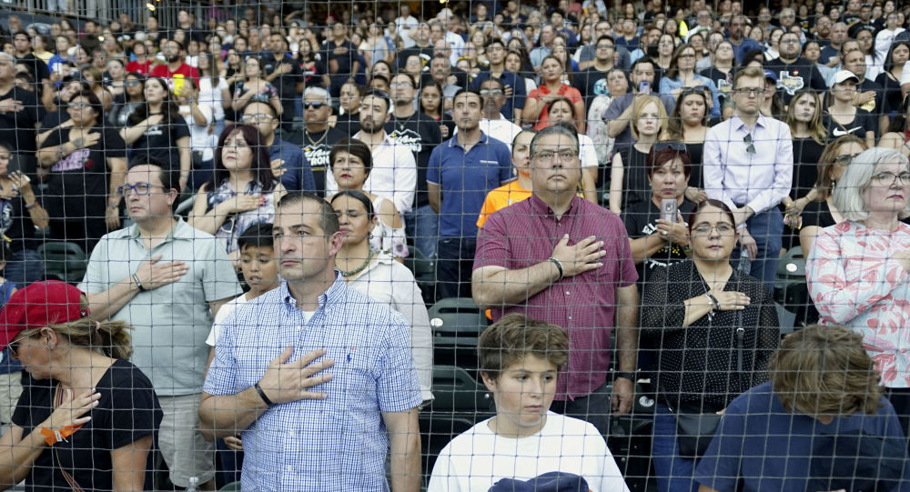 People attend a community memorial service honoring victims of the mass shooting earlier this month which left 22 people dead and 24 more injured, at Southwest University Park on August 14, 2019 in El Paso, Texas.