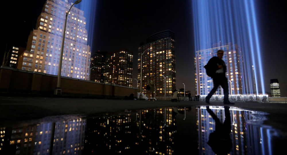A man walks by the Tribute in Light, lit to commemorate the 18th anniversary of September 11, 2001 attacks in New York City, U.S., September 10, 2019