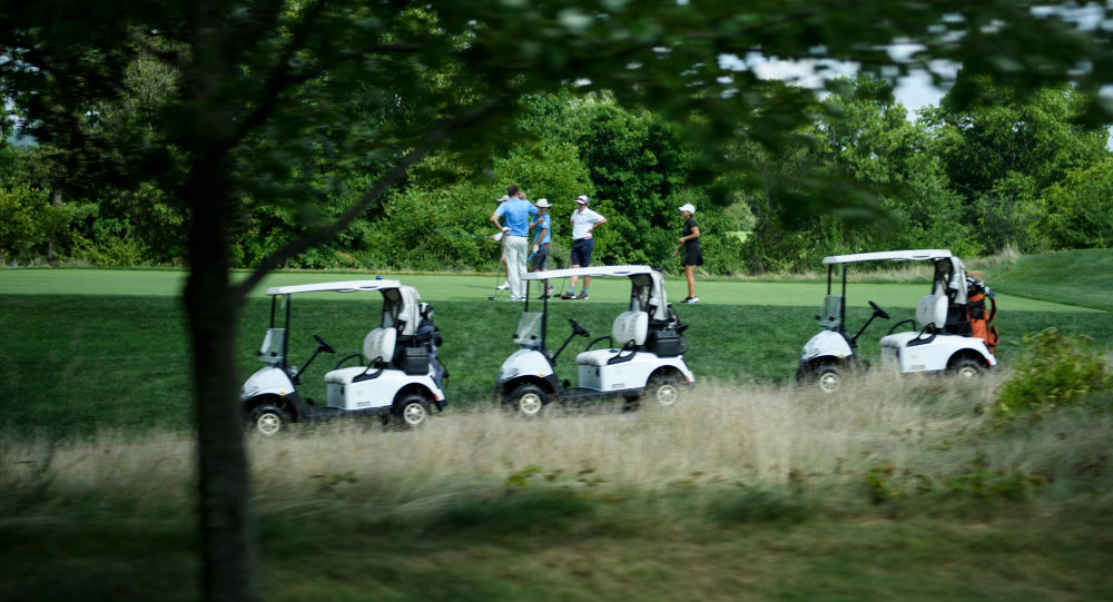 People play golf at the Trump National Golf Club August 9, 2018 in Bedminster, New Jersey