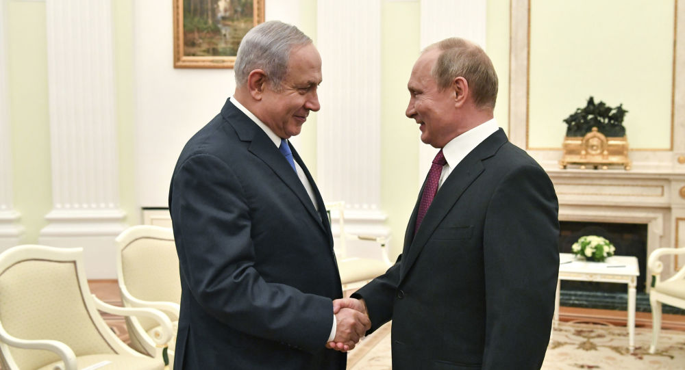 Russian President Vladimir Putin, right, shakes hands with Israeli Prime Minister Benjamin Netanyahu during their meeting at the Kremlin in Moscow, Wednesday, July 11, 2018