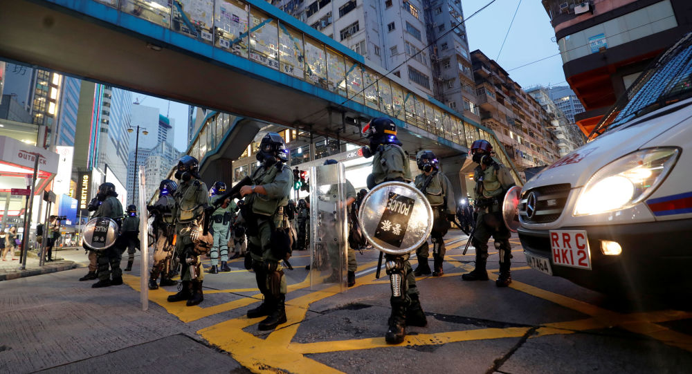 Riot police are seen near Causeway Bay MTR station during protests in Hong Kong
