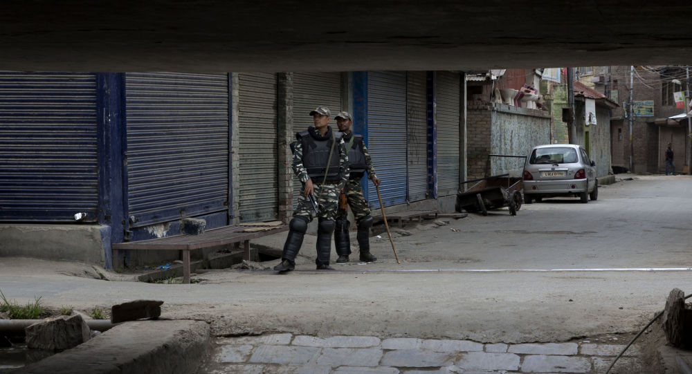 Indian paramilitary soldiers stand guard at a closed market in central Srinagar, Indian controlled Kashmir, Tuesday, Aug. 27, 2019