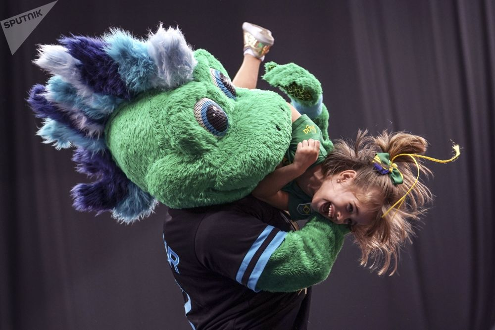 Gur-Gur, the mascot of this year's championships, holding a girl