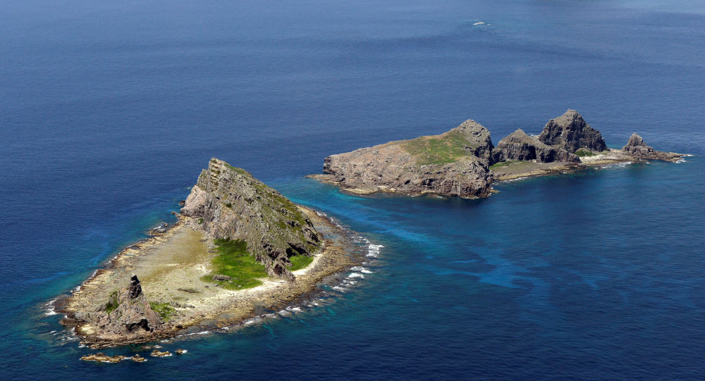 A group of disputed islands, Uotsuri island (top), Minamikojima (bottom) and Kitakojima, known as Senkaku in Japan and Diaoyu in China is seen in the East China Sea (File)