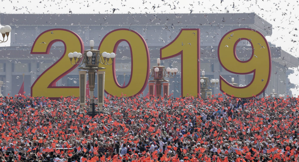 Doves are released over people holding Chinese flags at the end of the parade marking the 70th founding anniversary of People's Republic of China, on its National Day in Beijing, China October 1, 2019