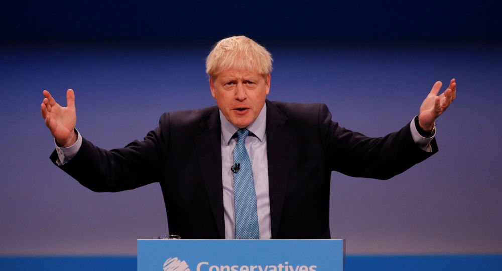 Britain's Prime Minister Boris Johnson gestures as he gives a closing speech at the Conservative Party annual conference in Manchester, 2 October 2019