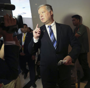 U.S. special envoy to North Korea Stephen Biegun is trailed by reporters as he walks at the media center during the ASEAN and East Asia summits in Bangkok, Thailand, Friday, Aug. 2, 2019