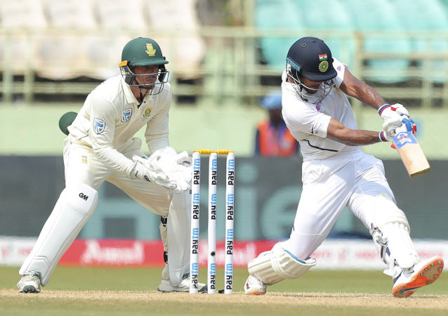 India's Mayank Agarwal plays a shot during the second day of the first cricket test match against South Africa in Visakhapatnam, India, Thursday, Oct. 3, 2019