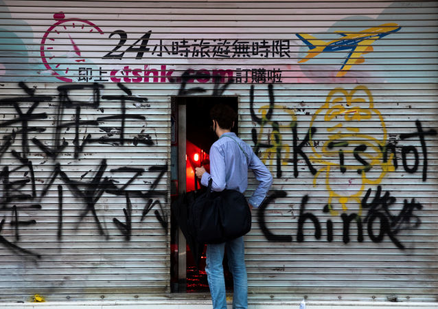A man stands in front of a shop destroyed by anti-government protesters during a demonstration in Wan Chai district, in Hong Kong, China October 6, 2019