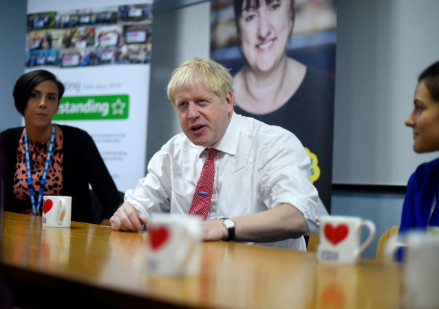British Prime Minister Boris Johnson speaks to mental health professionals as he visits Watford General Hospital in Watford, Britain October 7, 2019.
