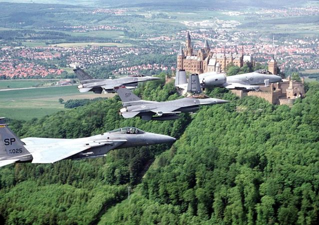 US fighter jets , an F-15 (L) two F-16 (C) and an A-10, assigned to Spangdahlem Air Base (Germany), fly a training past a German castle 10 March 1999.