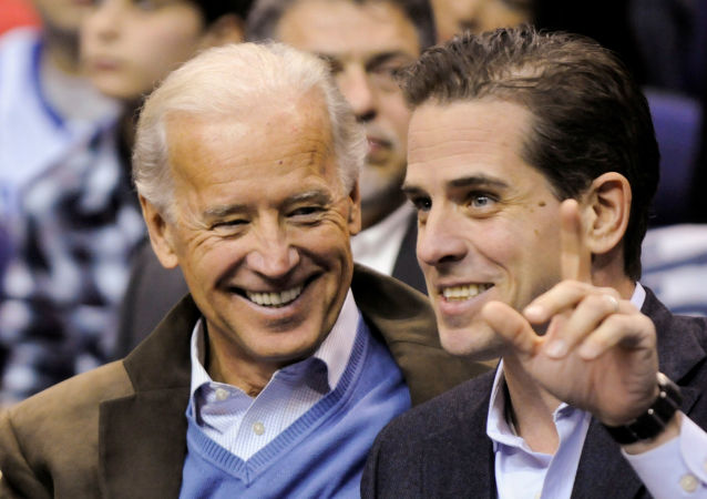 U.S. Vice President Joe Biden and his son Hunter Biden attend an NCAA basketball game between Georgetown University and Duke University in Washington, U.S., January 30, 2010. Picture taken January 30, 2010.