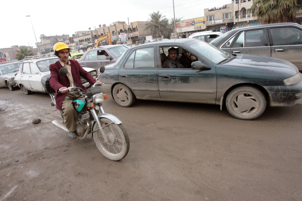 Iraqi postman Abu Ali rides through Baghdad, 09 January 2007.