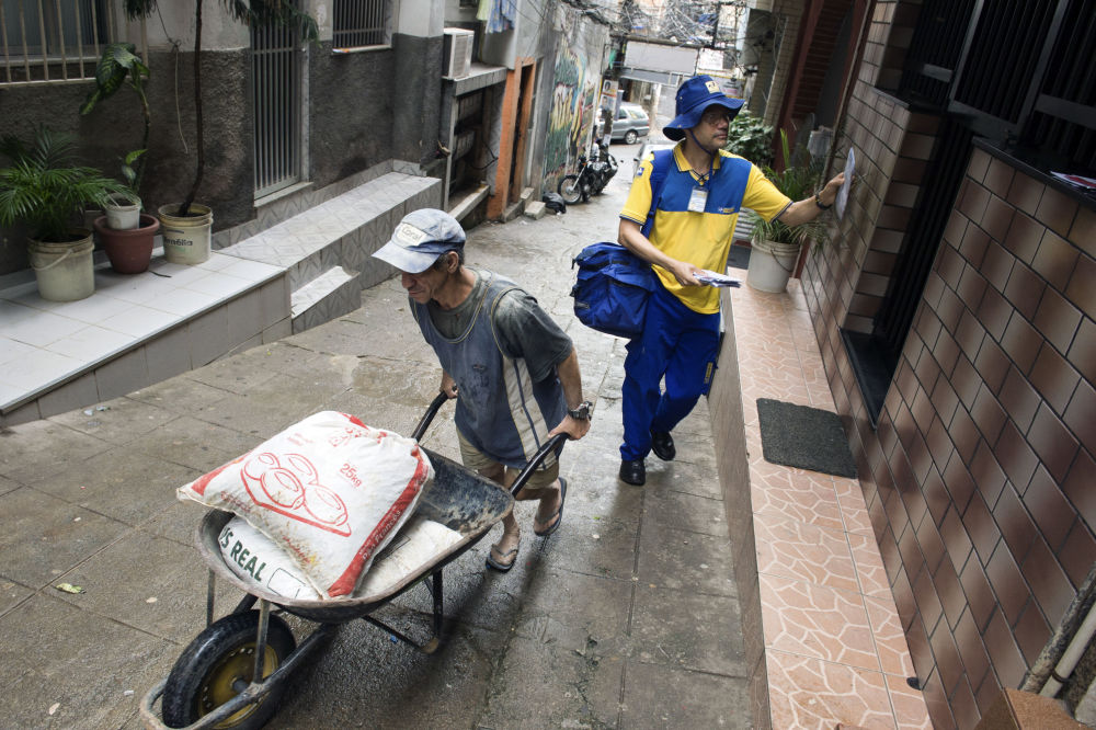 A Brazilian postman delivers letters in Rocinha slum in Rio de Janeiro on October 4, 2013.
