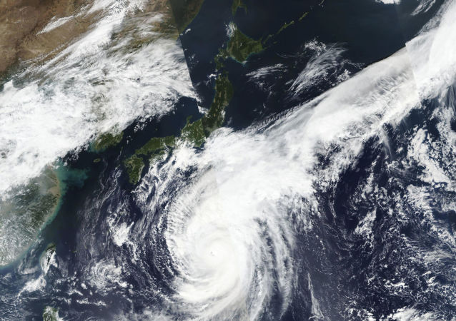 satellite photo taken by NASA-NOAA's Suomi NPP satellite shows typhoon Hagibis approaching Japan