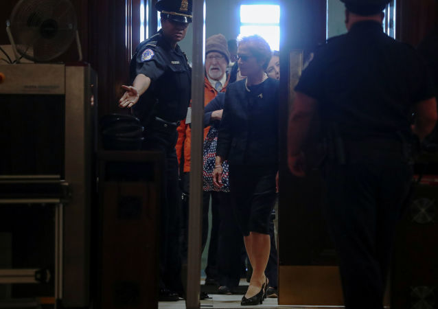 Former U.S. ambassador to Ukraine Marie Yovanovitch makes her way through security as she arrives to testify in the U.S. House of Representatives impeachment inquiry into U.S. President Trump on Capitol Hill in Washington, U.S., October 11, 2019