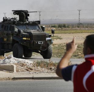 A Turkish police armoured vehicle patrols the border between Turkey and Syria, in Akcakale, Sanliurfa province, southeastern Turkey
