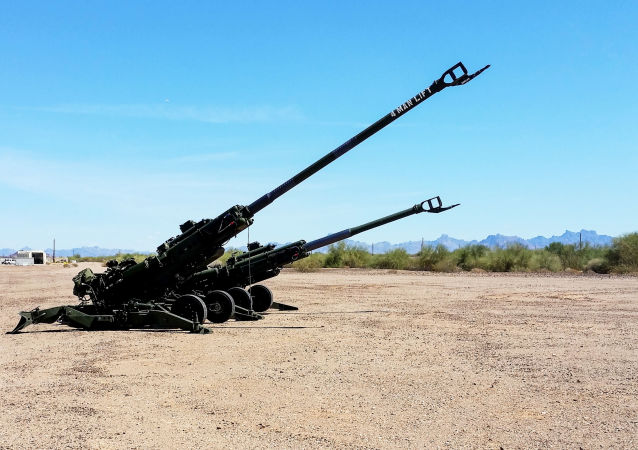 "The M777A2 and M777ER side by side at a test site. Retrofitting an M777A2 howitzer into an M777ER—the ""ER"" stands for extended range—only requires changing five components, which add little additional weight or cost. The long-range cannon project team is evaluating whether equipping artillery batteries with the extended-range howitzer plus new radar and tracking systems can increase their firepower while the Army develops more significant modernization solutions for long-range precision fires. (Photos courtesy of the authors)"