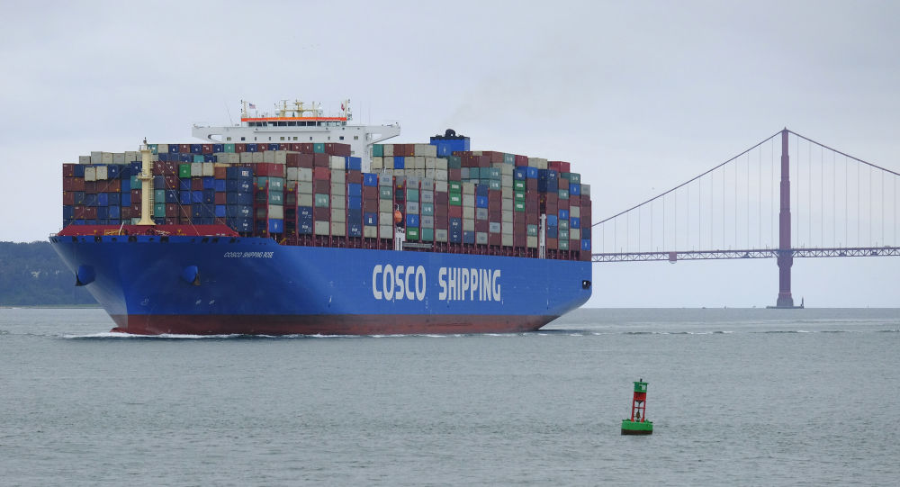 A Cosco Shipping container ship passes the Golden Gate Bridge Tuesday, May 14, 2019, in San Francisco bound for the Port of Oakland