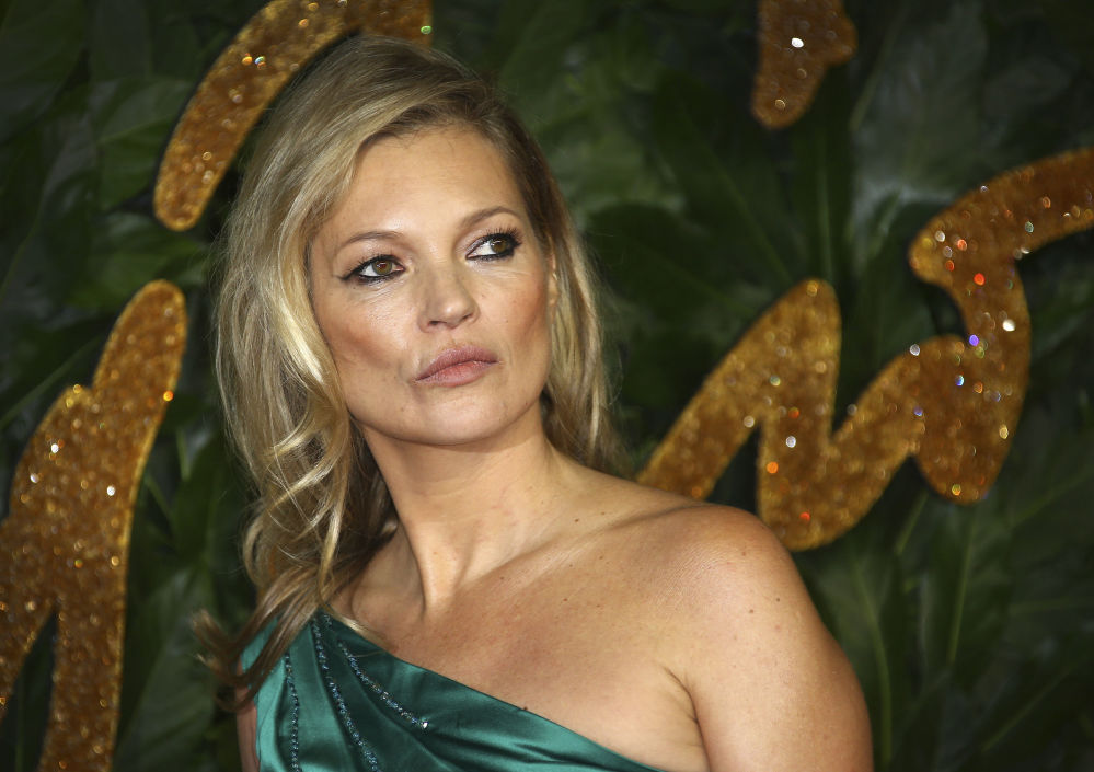 Kate Moss poses for photographers upon arrival at the The Fashion Awards 2018 in central London, Monday, Dec. 10, 2018.