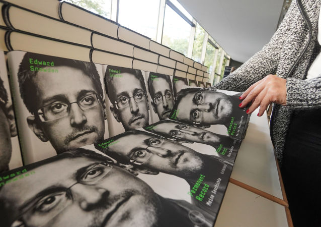 Copies of the book titled Permanent Record by US former CIA employee and whistleblower Edward Snowden are for sale on the sidelines of a video conference in that he spoke about the book on September 17, 2019 in Berlin
