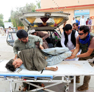 Men carry an injured person to a hospital after a bomb blast at a mosque, in Jalalabad, Afghanistan October 18, 2019