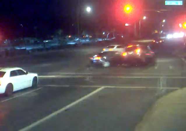 Dramatic traffic footage released by the City of Phoenix Police Department captures family's near-death experience after driver runs red light.